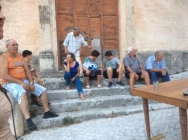 Neighborhood gathering for pizza on the piazza, Peschio, Italy